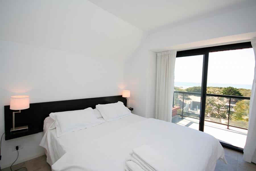 Foto dormitorio edificio playas